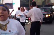 شاهد بالفيديو ..إخواني يعتدي على محتفلين بقناة السويس امام السفارة المصرية